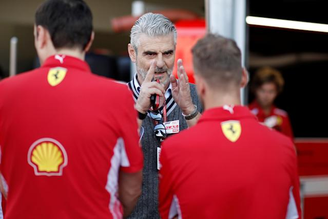 Formula One F1 - Monaco Grand Prix - Circuit de Monaco, Monte-Carlo - May 23, 2018 Ferrari Team Principal Maurizio Arrivabene and Sebastian Vettel in the pit-lane. REUTERS/Benoit Tessier