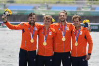 Lucas Theodoor Dirk Uittenbogaard, Abe Wiersma, Tone Wieten and Koen Metsemakers, of the Netherlands, pose with the gold medal following the men's rowing quadruple sculls final at the 2020 Summer Olympics, Wednesday, July 28, 2021, in Tokyo, Japan. (AP Photo/Darron Cummings)