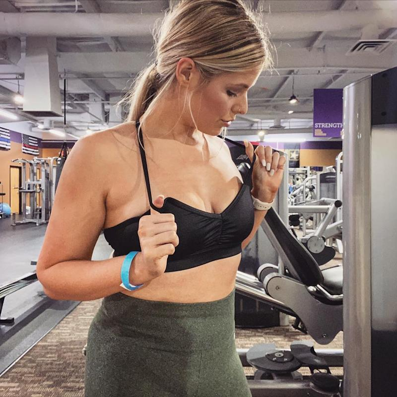 Woman wearing a black sports bra in a gym