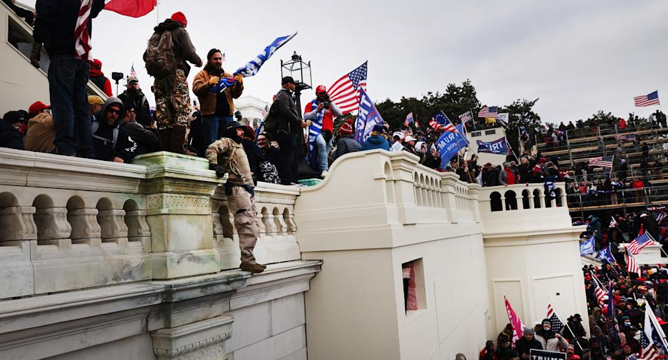 Rioters climbed walls and broke through barricades after marching from Trump's speech. Source: Getty Images