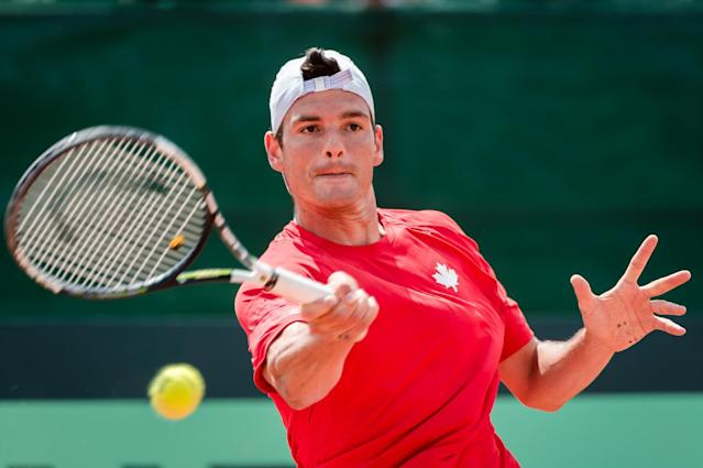 Canada's Frank Dancevic returns the ball to Belgium's ?Steve Darcis during the first singles ?match of the Davis Cup World Group quarterfinal between Belgium and Canada, in Middelkerke, Belgium, on Friday July 17, 2015. (AP Photo/Geert Vanden Wijngaert)