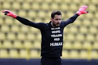 """Dortmund goalkeeper Roman Burki wears a T-shirt reading """"black, white, yellow, red, HUMAN"""" in solidarity with protests raging across the US over the death of George Floyd (AFP Photo/Lars Baron)"""