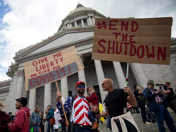 People protest at Washington's capitol building against the state's extended stay-at-home order.