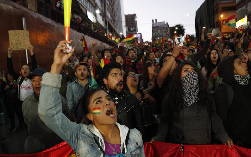 Anti-government protesters march demanding a second round presidential election in La Paz, Bolivia, Saturday, Oct. 26, 2019. Bolivia's official vote tally was revealed Friday pointing to an outright win for incumbent Evo Morales in a disputed presidential election that has triggered protests and growing international pressure on the Andean nation to hold a runoff ballot. (AP Photo/Juan Karita)