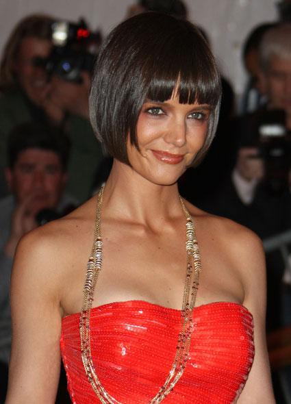 Talk about bob goals! Katie Holmes went with a drastically different 'do for her red carpet appearance at the Met Gala in New York City. WATCH: Katie Holmes and Suri Cruise Play Dress Up – See the Cute Photos! Katie rocked a custom Zac Posen gown to the annual benefit, and to say the least -- it was stunning. . Apparently Katie was pretty pleased herself with the look, as the actress couldn't help but to post a big slow-motion video debuting the cut to her Instagram. And achieving the look was no small feat, as earlier Instagrams show Katie literally hanging upside down while her hair was cut. There's something so completely horrifying about scissors and gravity. WATCH: Katie Holmes and Jamie Foxx Reportedly Dating, Photographed Holding Hands This is a big change from Katie's long wavy locks during her recent appearance at the Tribeca Film Festival. Getty Images While the cut is certainly bold, it's nothing new for Katie Holmes, who actually donned a similar look to the gala in 2008, while she was still with ex-husband Tom Cruise. Getty Images She basically owns the bob. The bob is Katie's now. Gala = success. Now, watch Katie Holmes share a rare photo playing dress up with Suri Cruise.