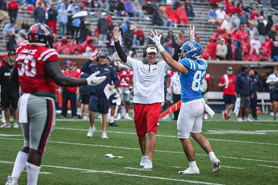 Ole Miss coach Lane Kiffin celebrates after his team scores a touchdown in the 2021 Grove Bowl.