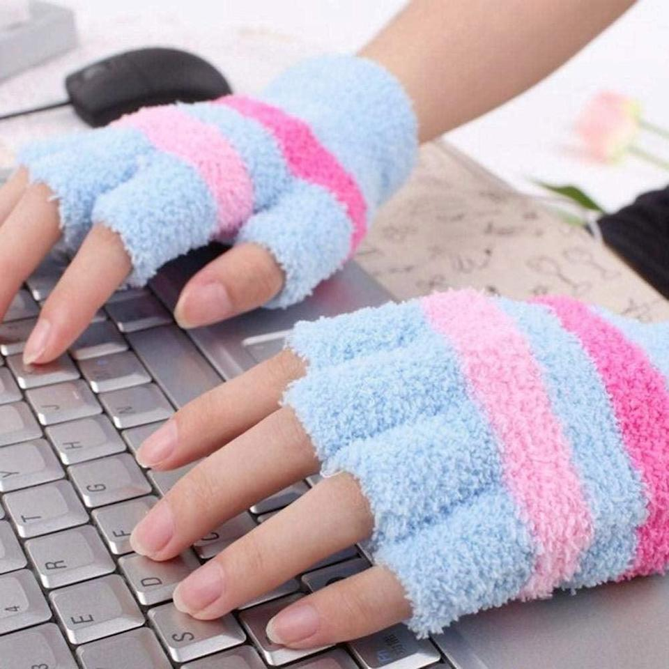 <p>They can keep their fingers warm as they work on homework with these <span> USB Heated Mittens </span> ($4).</p>