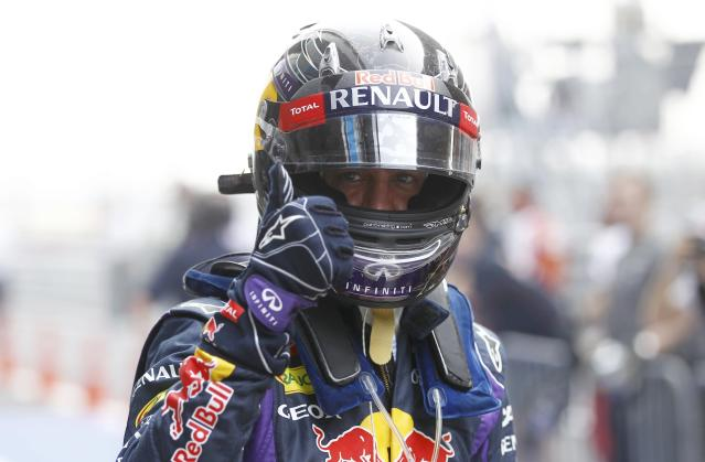 Red Bull Formula One driver Sebastian Vettel of Germany reacts after the qualifying session of the Indian F1 Grand Prix at the Buddh International Circuit in Greater Noida, on the outskirts of New Delhi, October 26, 2013. REUTERS/Adnan Abidi (INDIA - Tags: SPORT MOTORSPORT F1)