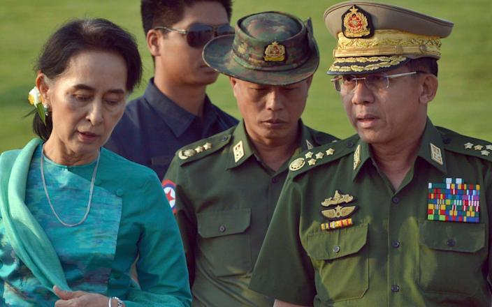 Aung San Suu Kyi and General Min Aung Hlaing were reported to have a tense relationship - Aung Shine Oo/AP