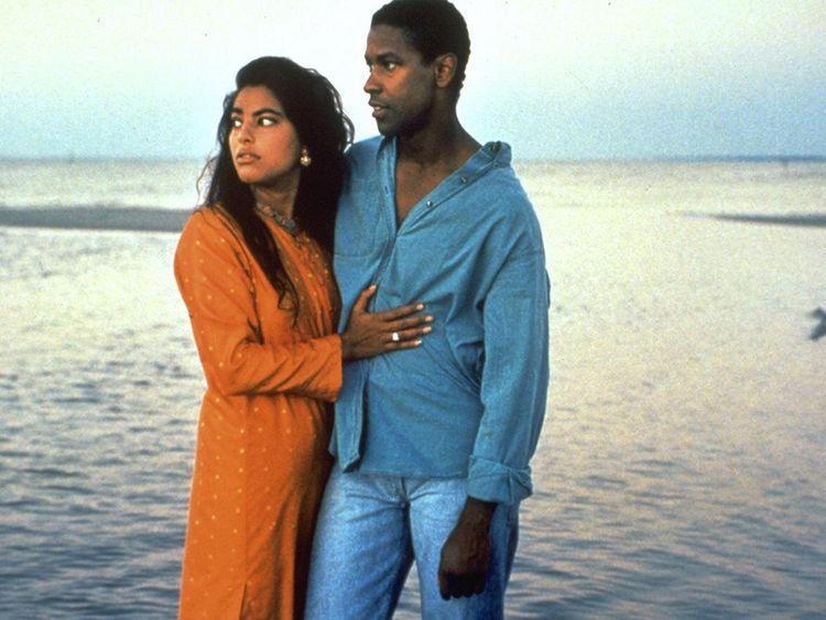 """<p>When she was a girl, Mina (Sarita Choudhury) and her family were forced out of Uganda, along with the country's other Indian inhabitants, at the behest of the dictator Idi Amin. Ever since, she's lived in Mississippi, feeling like her life's on pause. Then she meets Demetrius (Denzel Washington), and the future looks brighter—but it's not one her parents are enthusiastic about. <em>Mississippi Masala </em>isn't streaming—but the Mira Nair-directed movie is worth watching, however necessary, for Washington and Choudhury's performances as characters who believe in each other, and are willing to risk it all as a result. Luckily, the <a href=""""https://gulfnews.com/entertainment/hollywood/mira-nair-to-re-release-mississippi-masala-1.77169882#:~:text='Mississippi%20Masala'%20re%2Dmastered,%2Dyear%2Dold%20director%20wrote."""" rel=""""nofollow noopener"""" target=""""_blank"""" data-ylk=""""slk:movie is being re-released"""" class=""""link rapid-noclick-resp"""">movie is being re-released</a> in 2021 for its 30th anniversary, so you'll be able to stream it soon.</p>"""