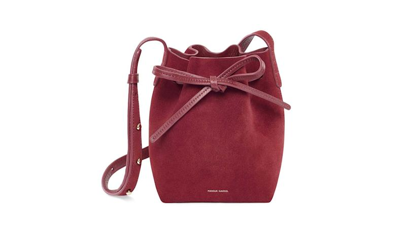 The Mansur Gavriel suede mini mini bucket bag that Malia Obama was carrying retails for $495 on mansurgavriel.com.