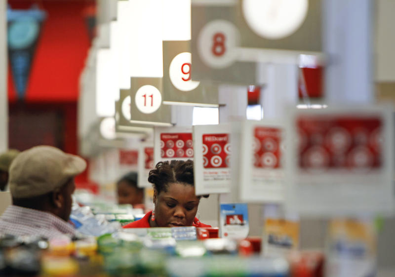 In this Wednesday, Aug. 22, 2012, photo, a cashier rings up a sale at a Target store in Chicago on Wednesday, Aug. 22, 2012. A private research group says that consumer confidence unexpectedly fell in August to the lowest level since November 2011, as Americans' outlook about jobs flared up. The New York-based Conference Board said Tuesday, Aug. 28, 2012, that its Consumer Confidence Index fell to 60.6, down from a revised 65.4 in July. Economists had expected a reading of 66. The index now stands at the lowest point since November 2011 when the reading was at 55.2. (AP Photo/Sitthixay Ditthavong)