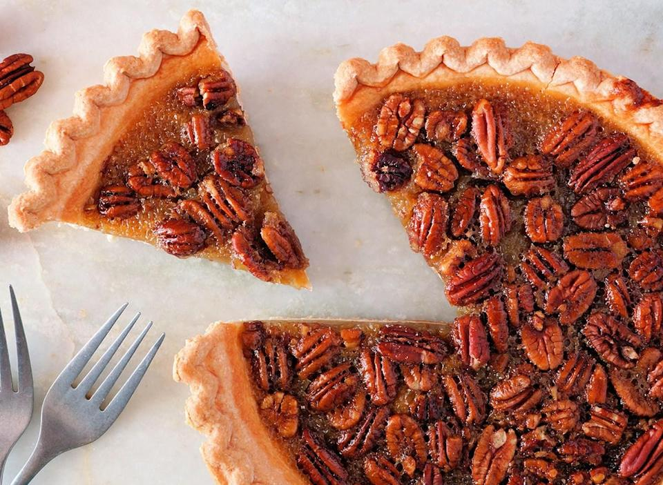 whole pecan pie with slice