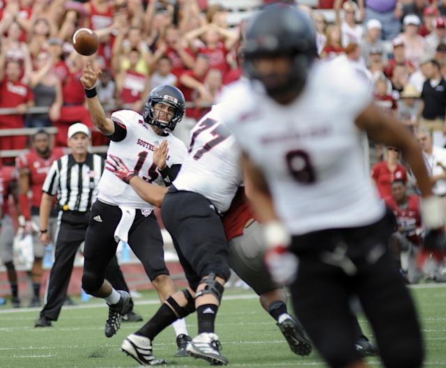 Southern Utah quarterback Aaron Cantu throws against Washington State during the first half of an NCAA college football game, Saturday, Sept. 14, 2013, in Pullman, Wash. (AP Photo/Rajah Bose)