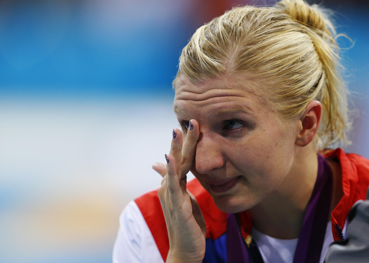 Britain's Rebecca Adlington wipes away tears after receiving her bronze medal on the podium during the women's 800m freestyle victory ceremony at the London 2012 Olympic Games at the Aquatics Centre August 3, 2012.       REUTERS/Michael Dalder (BRITAIN  - Tags: SPORT SWIMMING OLYMPICS)