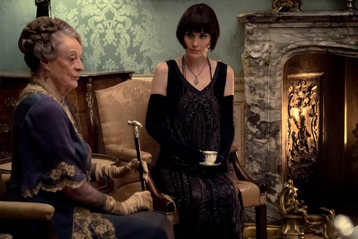 Maggie Smith (left) stars as Violet Crawley and Michelle Dockery as Lady Mary in the 2019 movie Downton Abbey. | Jaap Buitendijk—Focus Features