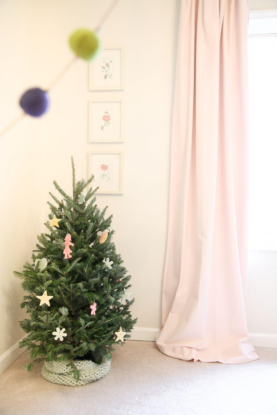 "<p>A personal tree will get your little one more excited than a kid on, well, Christmas morning. This minimally adorned Christmas tree by <a href=""http://julieblanner.com/christmas-decorations/"" rel=""nofollow noopener"" target=""_blank"" data-ylk=""slk:Julie Blanner"" class=""link rapid-noclick-resp"">Julie Blanner</a> adds a little touch of charm to a daughter's room but is likely to bring a big smile to anyone awaiting Santa this season. </p>"