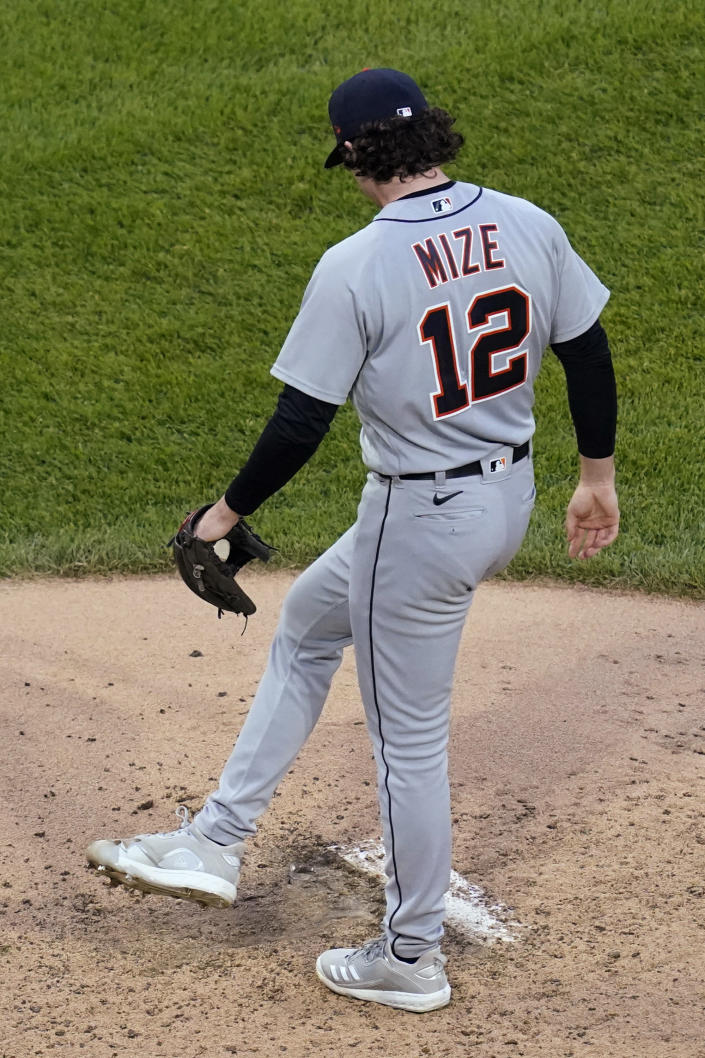 Detroit Tigers starting pitcher Casey Mize kicks at dirt near the rubber during the second inning of the team's baseball game against the Chicago White Sox in Chicago, Thursday, June 3, 2021. (AP Photo/Nam Y. Huh)