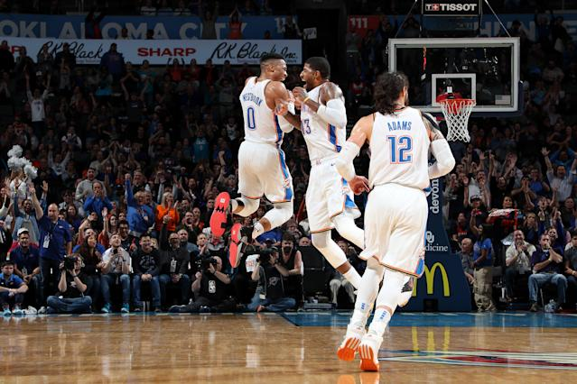 OKLAHOMA CITY, OK - FEBRUARY 11: Russell Westbrook #0 and Paul George #13 of the Oklahoma City Thunder react to a play during the game against the Portland Trail Blazers on February 11, 2019 at Chesapeake Energy Arena in Oklahoma City, Oklahoma. (Photo by Zach Beeker/NBAE via Getty Images)