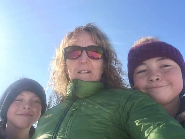 Shari Coxford with her two kids. Coxford said it's frustrating to hear little about reopening in the N.W.T. when the neighbouring territory is prepared to welcome vaccinated travellers without restrictions.