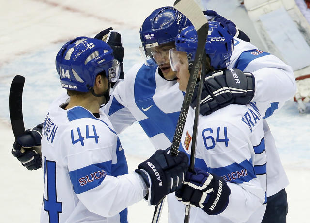 Team Finland celebrates a first period goal against Austria during a men's ice hockey game at the 2014 Winter Olympics, Thursday, Feb. 13, 2014, in Sochi, Russia. (AP Photo/Mark Humphrey)