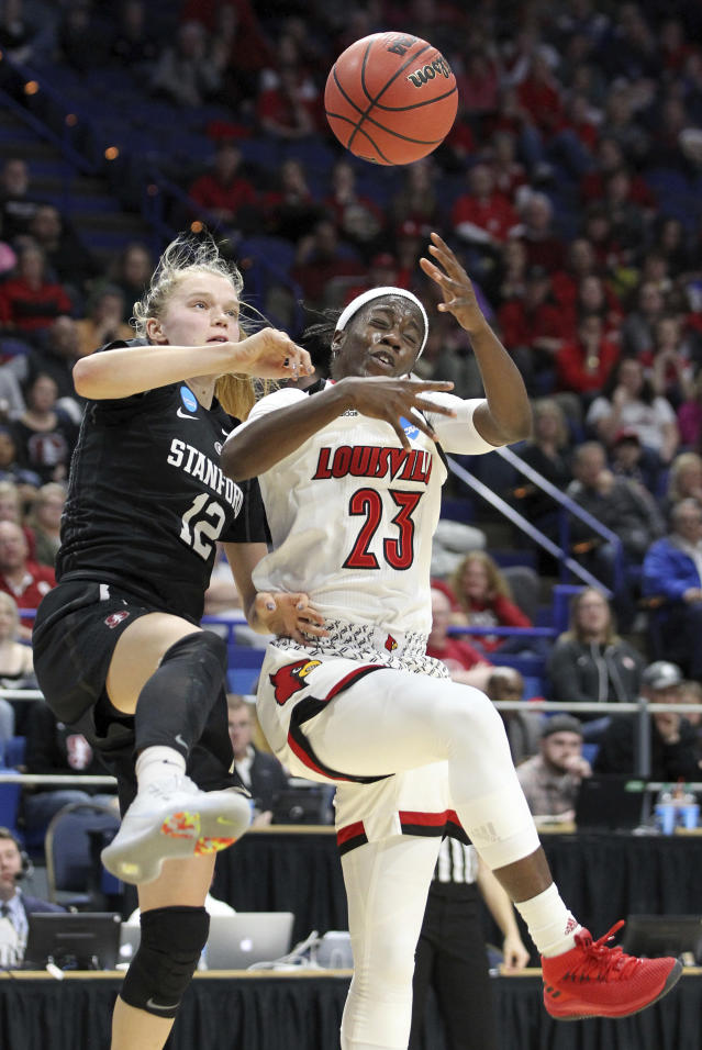 Stanford's Brittany McPhee (12) and Louisville's Jazmine Jones (23) compete for a rebound during the second half of an NCAA women's college basketball tournament regional semifinal, Friday, March 23, 2018, in Lexington, Ky. (AP Photo/James Crisp)