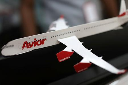 The corporate logo of Avior Airlines is seen in a scale model airplane at their office in Caracas, Venezuela May 15, 2019. REUTERS/Manaure Quintero