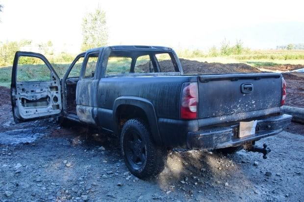 IHIT has taken over the investigation after a body was found inside a burned black pickup truck in Maple Ridge, B.C. (Ridge Meadows RCMP - image credit)