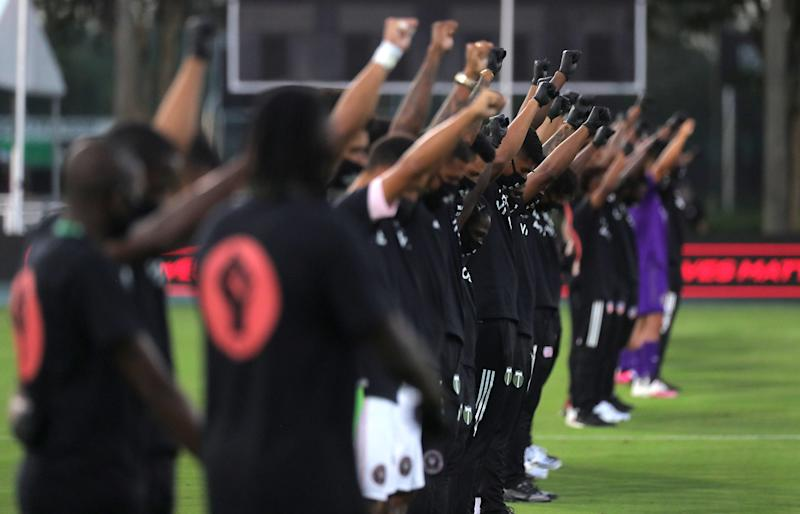 Orlando City, Inter Miami and members of the Black Players for Change coalition staged a powerful protest before MLS kicked off again Wednesday night. (Photo courtesy of the MLS via Getty Images)