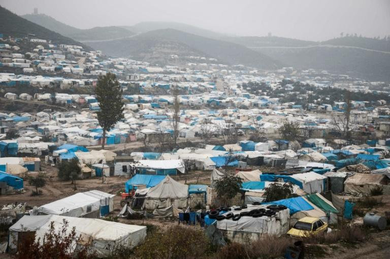 This picture taken on December 12, 2019 shows  a camp for displaced Syrians at Khirbet al-Joz in Syria's Idlib province near Turkey; most of its residents survive on aid brought across the border