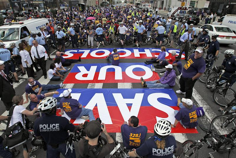 Protestors are ringed by Philadelphia police as they sit in Broad Street in an ac of civil disobedience during a protest of Pennsylvania Gov. Tom Corbett's proposed cuts to the education budget Wednesday, May 23, 2012 in Philadelphia. (AP Photo/Alex Brandon)