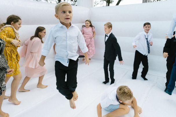 PHOTO: Kids bounce on the castle at Adalynn and Flo Toma's wedding. (Kay Salera)
