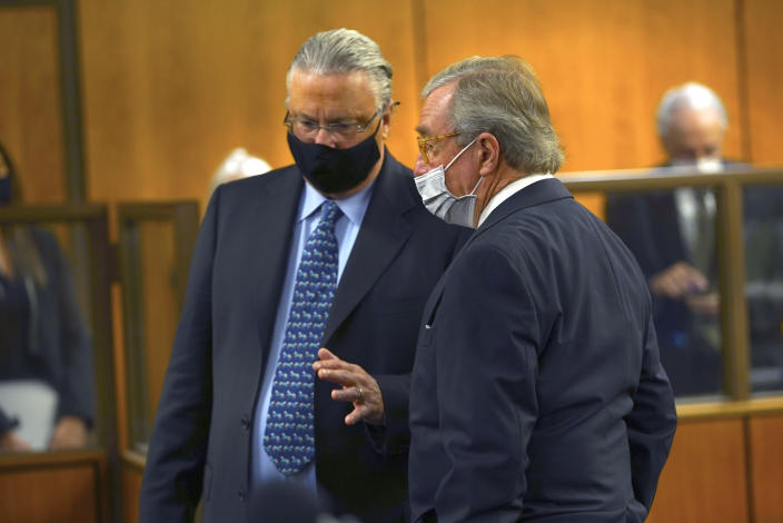 Defense attorneys David Z. Chesnoff, left, and Dick DeGuerin talk to each other during the murder trial of Robert Durst Monday, May 17, 2021, in Inglewood, Calif. The murder trial of the multimillionaire has resumed in Los Angeles County after a 14-month recess without the defendant present and with arguments about whether the case should continue at all. (Al Seib/Los Angeles Times via AP, Pool)