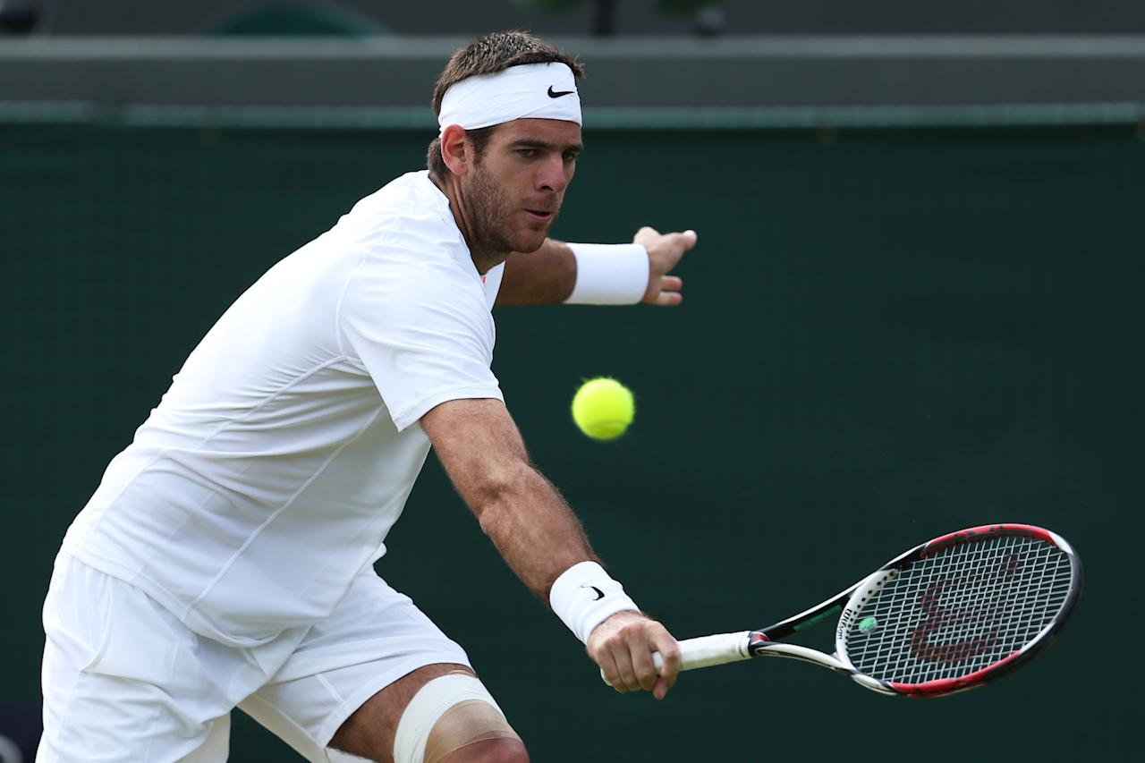 LONDON, ENGLAND - JULY 01: Juan Martin Del Potro of Argentina plays a backhand during the Gentlemen's Singles fourth round match against Andreas Seppi of Italy on day seven of the Wimbledon Lawn Tennis Championships at the All England Lawn Tennis and Croquet Club on July 1, 2013 in London, England. (Photo by Clive Brunskill/Getty Images)