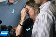 """CORRECTS SPELLING OF FIRST NAME TO NICHOLE INSTEAD OF NICOLE IN NYJM101-112 - Nichole Schmidt, mother of Gabby Petito, whose death on a cross-country trip has sparked a manhunt for her boyfriend Brian Laundrie, wipes tears from her eyes during a news conference, Tuesday, Sept. 28, 2021, in Bohemia, N.Y. Schmidt, along with Petito's father and two stepparents, were recently tattooed in memory of their child with the words, """"Let it be."""" (AP Photo/John Minchillo)"""