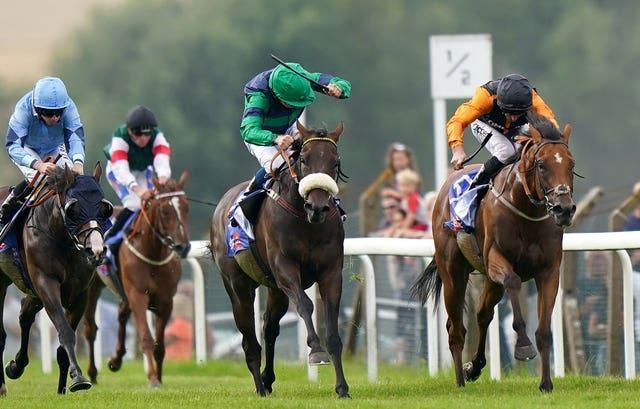 Brunch and William Buick (centre, green) coming home to win the Sky Bet Go-Racing-In-Yorkshire Summer Festival Pomfret Stakes at Pontefract