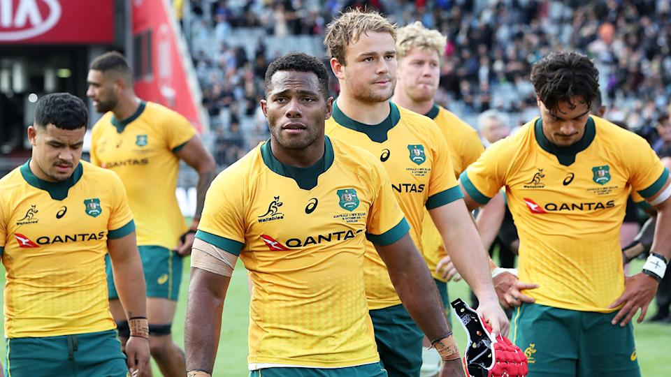 Pictured here, Wallabies players look dejected after another Eden Park mauling by the All Blacks.