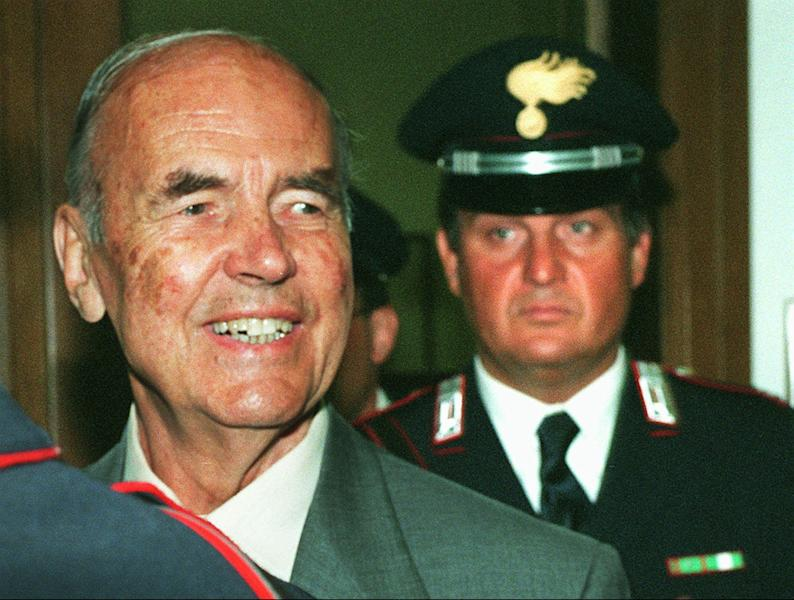FILE - In this July 19, 1996 file photo former Nazi officer Erich Priebke, left, arrives in a Rome Military Court followed by a Carabinieri Italian paramilitary police officer, for a hearing in his trial. Priebke, a former Nazi SS captain sentenced to life in prison for his role in one of the worst atrocities by German occupiers in Italy during World War II, has died. The LaPresse news agency quoted Priebke's lawyer Paolo Giachini as saying Priebke died Friday, Oct. 11, 2013, at age 100. Because of his age, Priebke had served his term under house arrest at Giachini's home. In 1994, Priebke was extradited to Italy from Argentina and put on trial for his role in the 1944 massacre outside Rome. Nazi forces killed 335 civilians to avenge an attack by resistance fighters that killed 33 members of a Nazi military police unit a day earlier. Priebke admitted shooting two people and rounding up victims, but insisted he was only following orders. (AP Photo/Plinio Lepri, File)