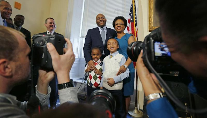 "William ""Mo"" Cowan poses with his family following a news conference at the Statehouse in Boston, Wednesday, Jan. 30, 2013, where he was named interim U.S. Senator for the seat vacated with the resignation of U.S. Sen. John Kerry, D-Mass. who will become secretary of state. With Cowan are his wife Stacy, and sons Grant, left, and Miles. (AP Photo/Charles Krupa)"