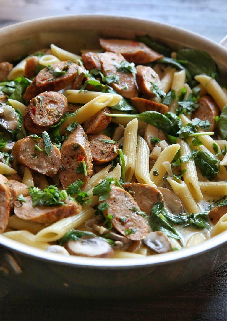 """<p>Creamy, garlicky pasta is what dreams are made of. This recipe calls for chicken sausage (Heck and Richmond do great varieties), but opt for pork sausages if you prefer. If using pork sausages, make sure they're cooked properly (around 10-12 minutes in the pan). </p><p>Get the <a href=""""https://www.delish.com/uk/cooking/recipes/a29571352/chicken-sausage-and-mushroom-penne-recipe/"""" rel=""""nofollow noopener"""" target=""""_blank"""" data-ylk=""""slk:Sausage & Mushroom Penne"""" class=""""link rapid-noclick-resp"""">Sausage & Mushroom Penne</a> recipe.</p>"""