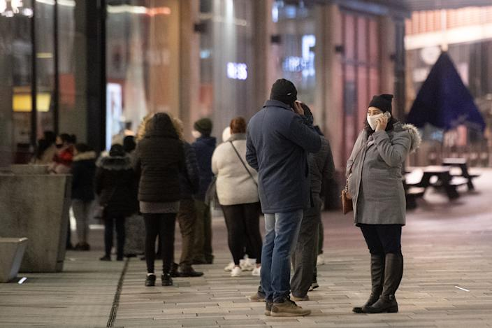 Shoppers queue outside Next in Leicester during the Boxing Day sales. Boxing Day spending is expected to fall by more than a quarter compared with a year ago, after extensive new Covid-19 restrictions forced non-essential retailers to close. (Photo by Joe Giddens/PA Images via Getty Images)