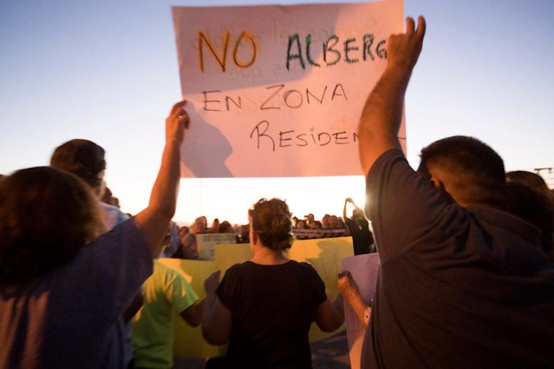 The Mexican government plans to convert a shuttered grocery store in Mexicali into a shelter for migrants awaiting immigration hearings in the United States. Here, protesters gather Monday, Oct. 14, 2019.