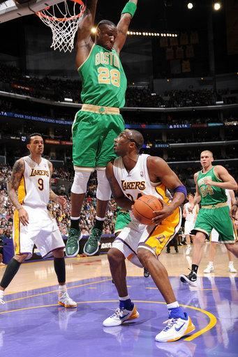 LOS ANGELES, CA - MARCH 11: Mickael Pietrus #28 of the Boston Celtics defends against Kobe Bryant #24 of the Los Angeles Lakers at Staples Center on March 11, 2012 in Los Angeles, California. (Photo by Andrew D. Bernstein/NBAE via Getty Images)