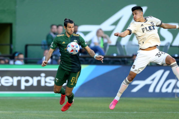Portland Timbers midfielder Diego Valeri controls a pass off his chest next to Los Angeles FC's Marco Farfanduring an MLS soccer match Wednesday, July 21, 2021, in Portland, Ore. (Sean Meagher/The Oregonian via AP)