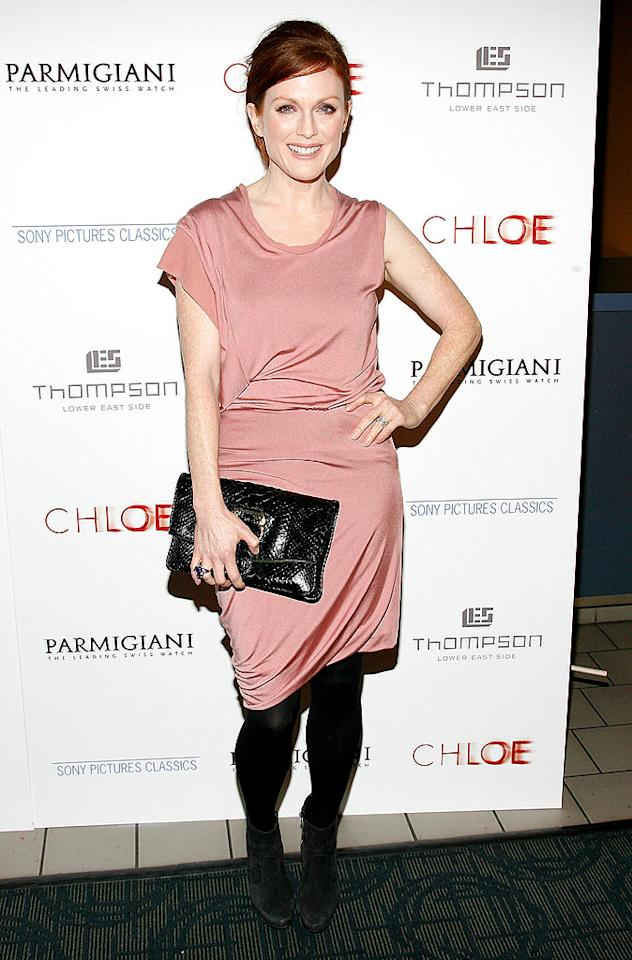 "Right behind Amanda in the arrivals line was her ""Chloe"" counterpart Julianne Moore, who opted for a simple yet stylish draped Calvin Klein dress, black tights, gray suede ankle boots, and a coveted Bulgari clutch. Joe Kohen/<a href=""http://www.wireimage.com"" target=""new"">WireImage.com</a> - March 15, 2010"