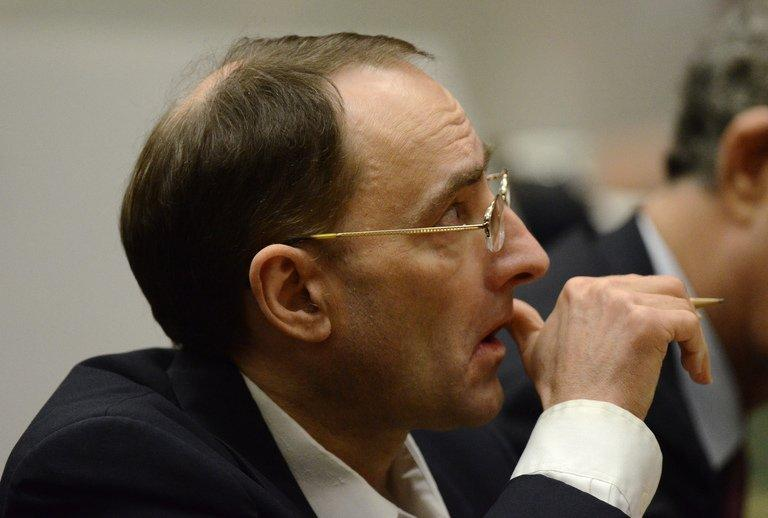 Defendant Christian Gerhartsreiter listens to the prosecutor during his murder trial at Los Angeles Superior Court on March 18, 2013 in Los Angeles, California. The German who posed as a Rockefeller family member after allegedly killing a man in California explained the freshly-dug soil in his back yard as plumbing work, a witness said