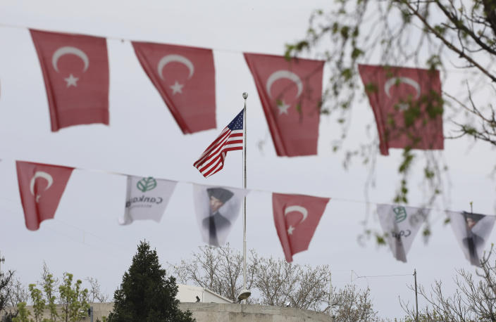 """Turkish flags and banners depicting Mustafa Kemal Ataturk, the founder of modern Turkey, decorate a street outside the United States embassy in Ankara, Turkey, Sunday, April 25, 2021. Turkey's foreign ministry has summoned the U.S. Ambassador in Ankara to protest the U.S. decision to mark the deportation and killing of Armenians during the Ottoman Empire as """"genocide."""" On Saturday, U.S. President Joe Biden followed through on a campaign promise to recognize the events that began in 1915 and killed an estimated 1.5 million Ottoman Armenians as genocide. (AP Photo/Burhan Ozbilici)"""