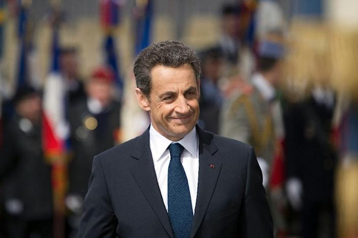 Then French president Nicolas Sarkozy takes part in a ceremony marking the 67th anniversary of the Allied victory over Nazi Germany in World War II, on May 8, 2012 at the Arc de Triomphe in Paris (AFP Photo/Lionel Bonaventure)