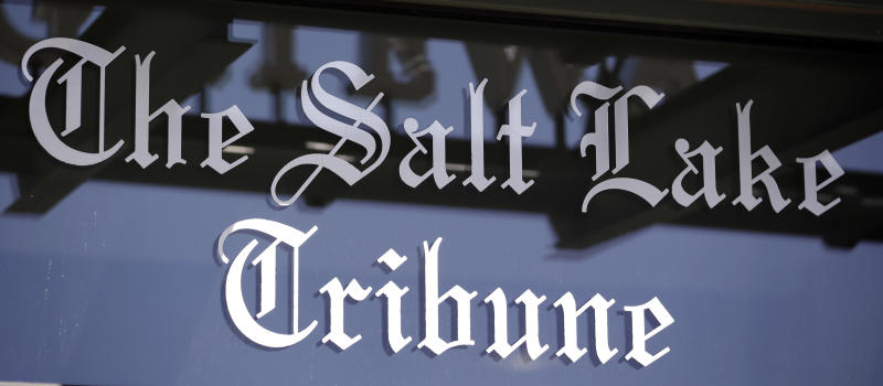 FILE- This April 20, 2016, file photo shows the Salt Lake Tribune sign in Salt Lake City. The Salt Lake Tribune says it has received approval from the IRS to convert into a nonprofit as the newspaper switches to a nontraditional model that it hopes will ensure long-term stability after years of financial struggles fueled by declines in advertising and circulation revenues.(AP Photo/Rick Bowmer, File)