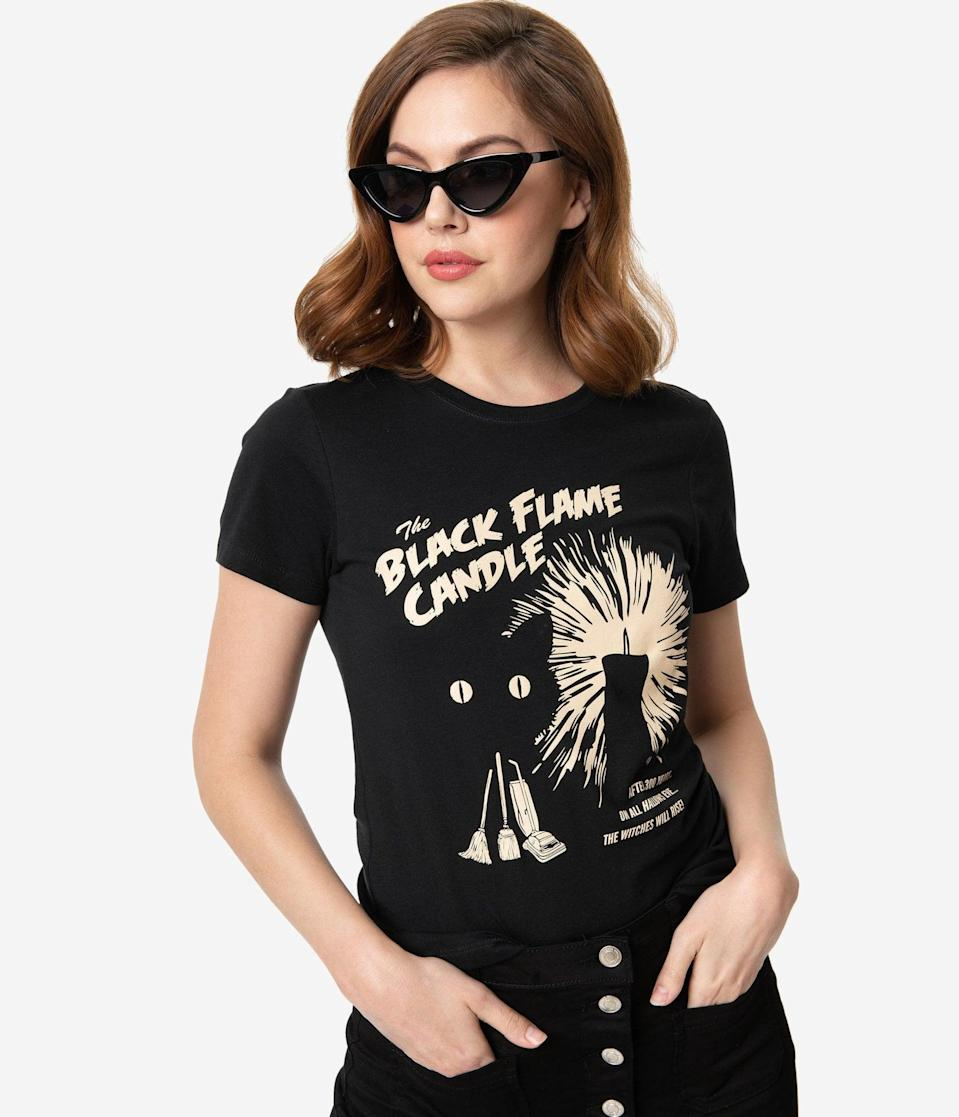 <p>The <span>Whosits and Whatsits Black Flame Candle Women's Tee</span> ($32) will pair perfectly with your spooky spirit.</p>